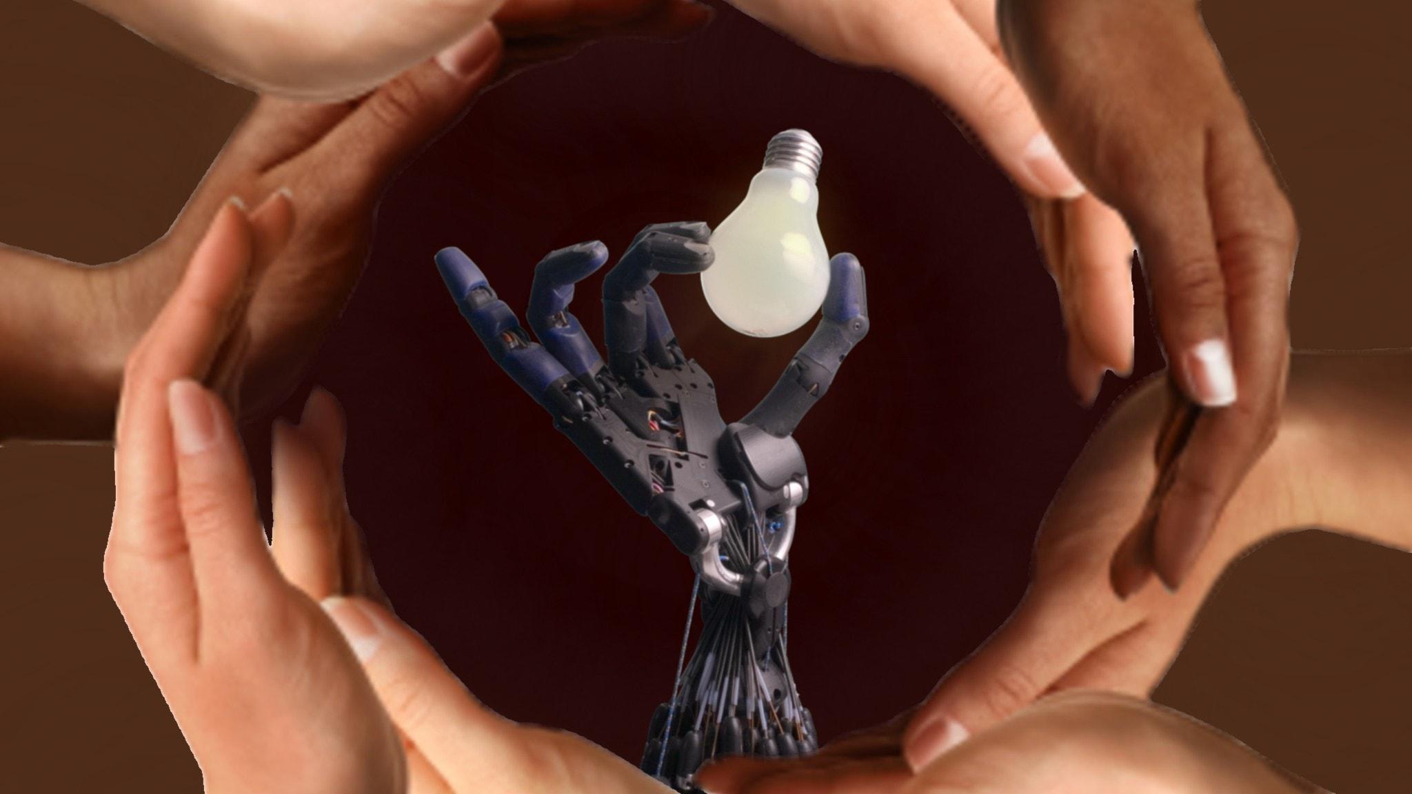 En robothand i en ring av händer.