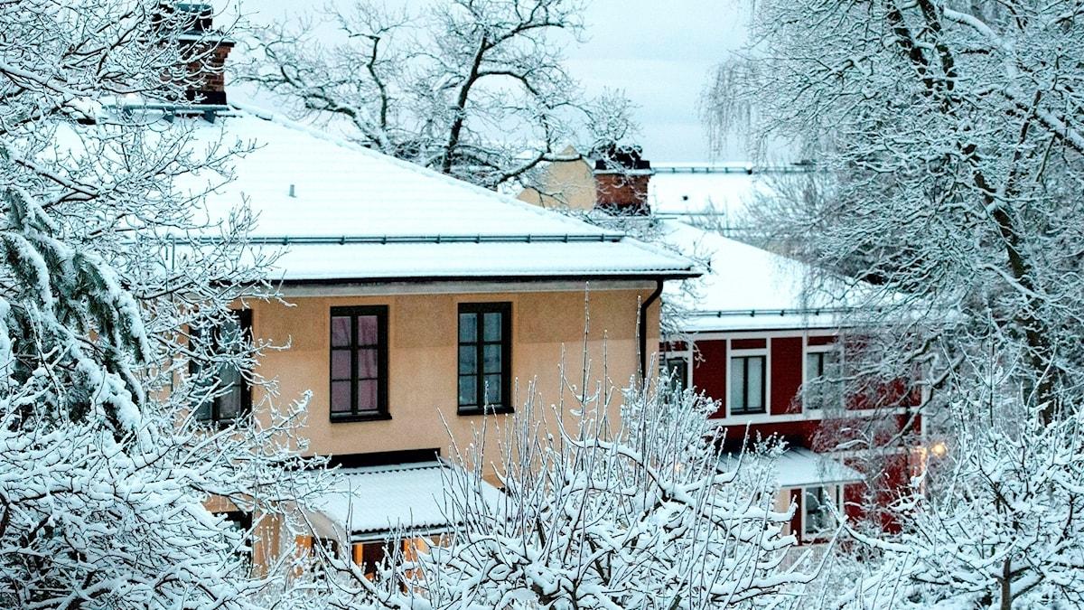 Villaområde i snö