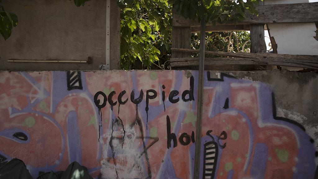 Graffitti på en husmur i området Sheikh Jarrah i Jerusalem.