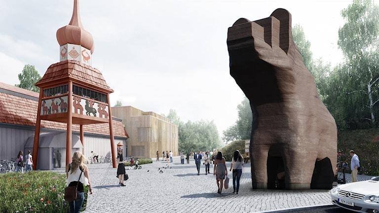Stor björnskulptur utanför ingång till museum.