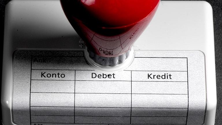Stämpel för debet och kredit.