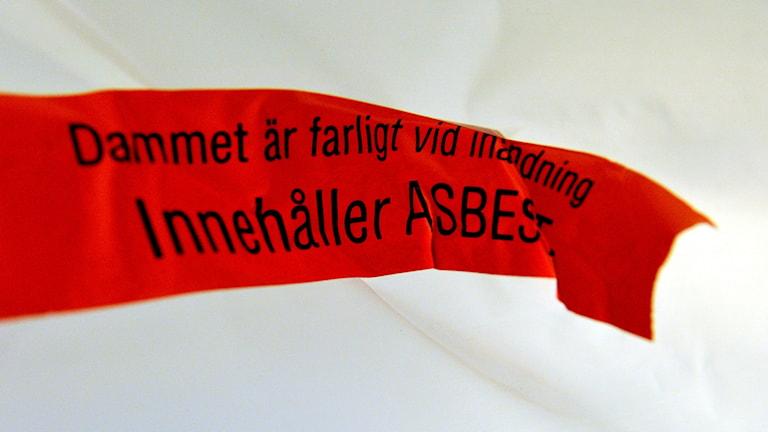 Varningsskylt för asbest.