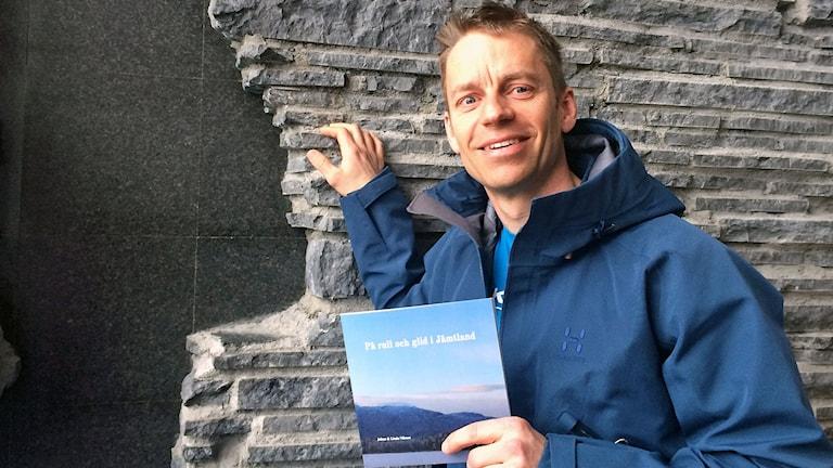 Johan Nilsson, man i blå jacka