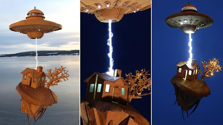 Pepparkakshus som föreställer ett UFO som sliter ett hus ur marken med någon slags stråle.
