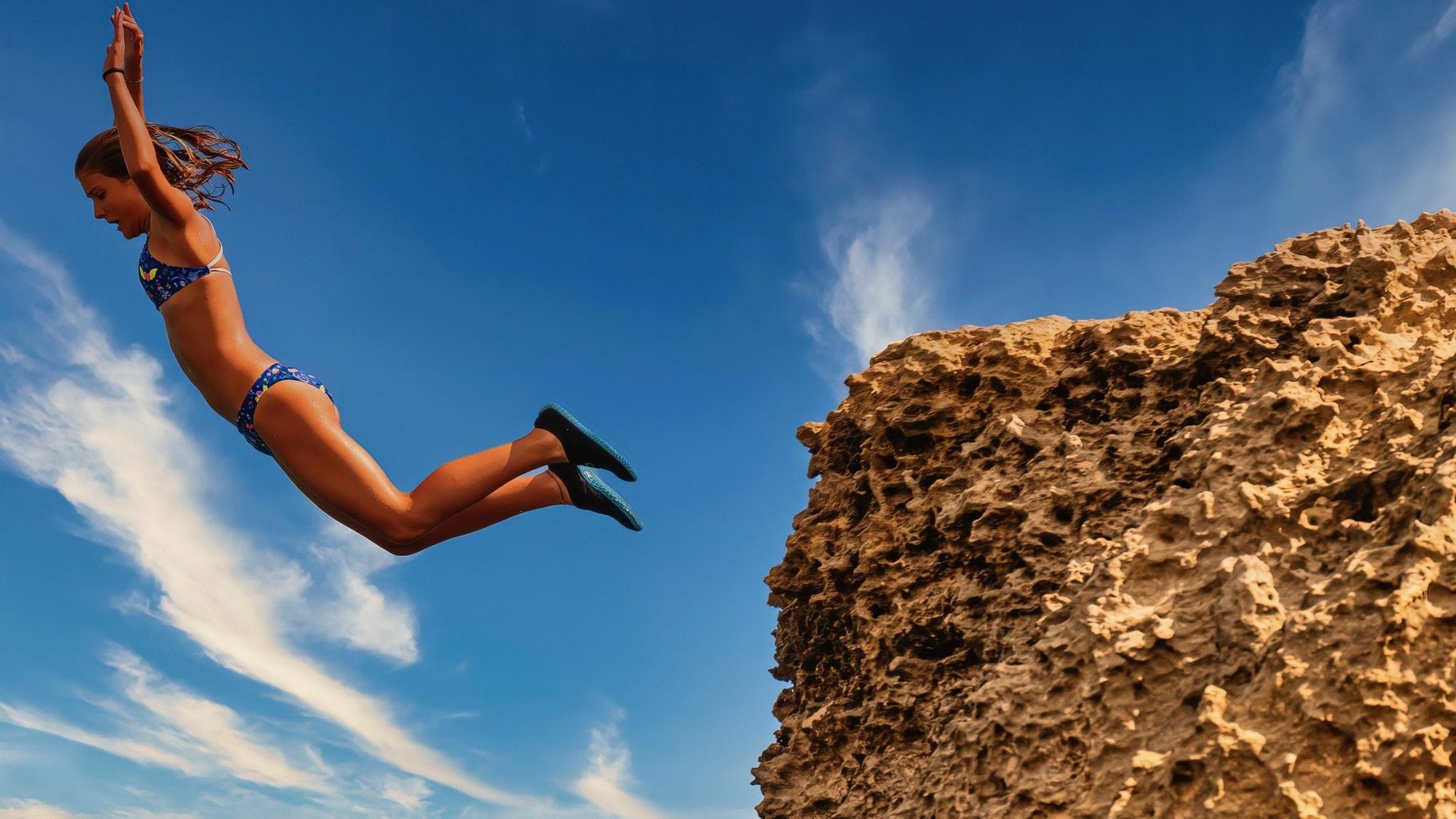 Flicka i baddräkt hoppar från klippa.