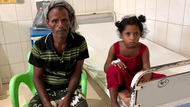 Morsela och hennes pappa på en sjuksäng