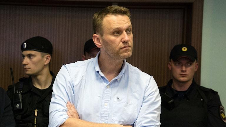 Oppositionspolitikern Aleksej Navalnyj i samband med ett domstolsförhör i juni i år.