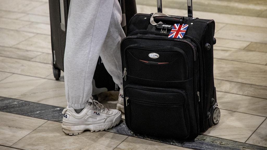 Person med resväska.