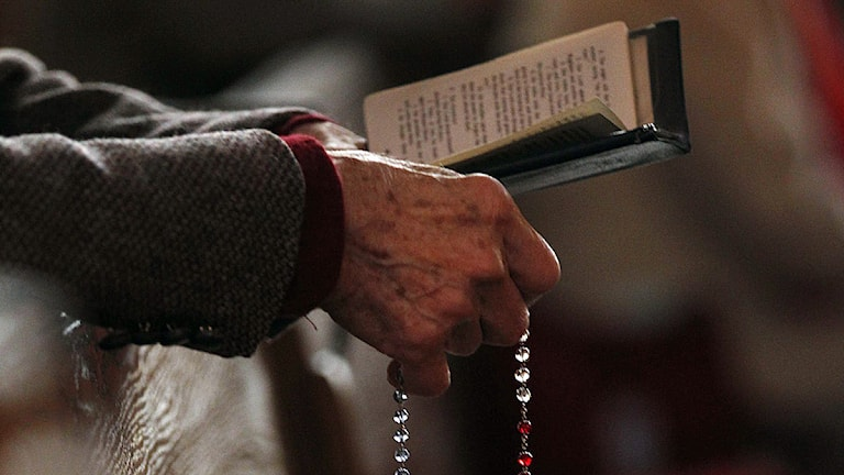 En församlingsmedlem ber. Foto: Jeffrey Phelps/Scanpix.