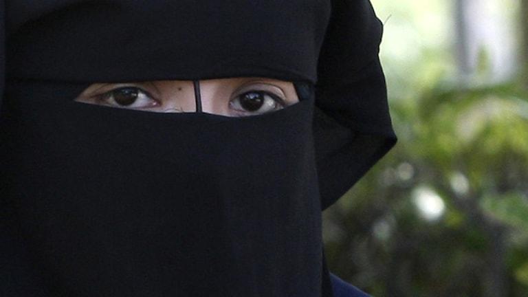 Kvinna med slöja för ansiktet. Arkivoto: Yves Logghe/Scanpix.