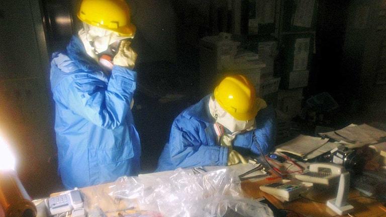 Arbetare inne i det havererade kärnkraftverket Fukushima. Foto: Tepco/Scanpix.