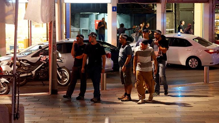 Säkerhetspersonal i området där skjutningen ägt rum.