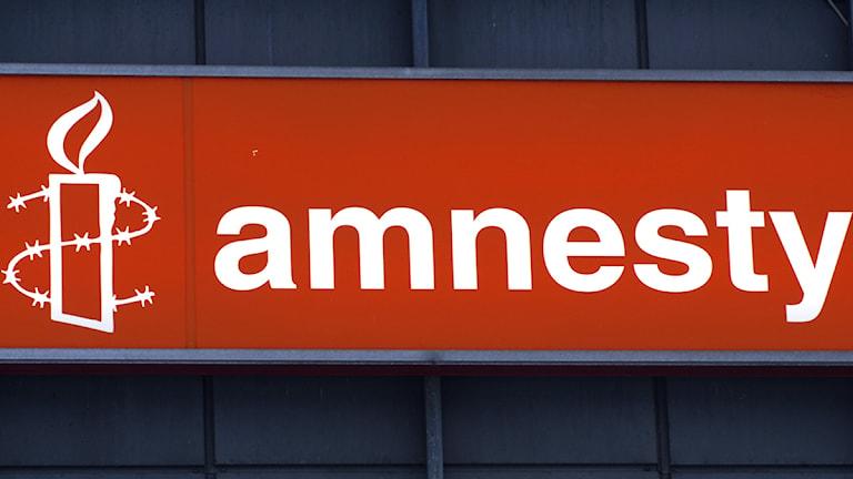 Amnesty Internationals logotype. Foto: Hasse Holmberg/Scanpix.