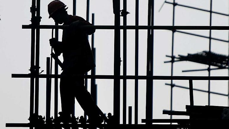 Byggnadsarbetare på ställning. Eugene Hoshiko/Scanpix