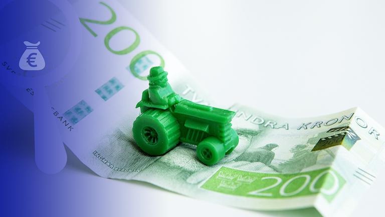Spelpjäs i form av traktor på svensk sedel