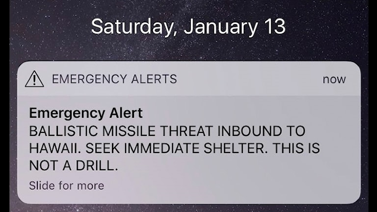 Mobilskärm med varningsmeddelande
