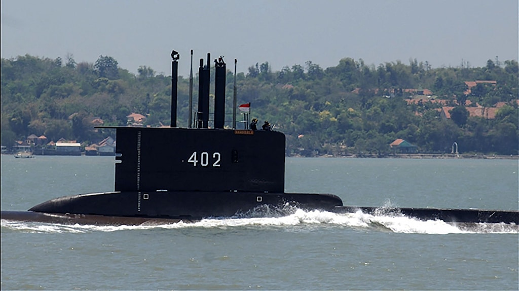 This undated handout from the Indonesia Military released on April 21, 2021 shows the Indonesian Cakra class submarine KRI Nanggala setting out from the naval base in Surabaya. - Indonesia's military said it was searching for the submarine with 53 crew aboard after losing contact with the vessel during naval exercises off the coast of Bali on April 21, 2021. (Photo by Handout / INDONESIA MILITARY / AFP) / --