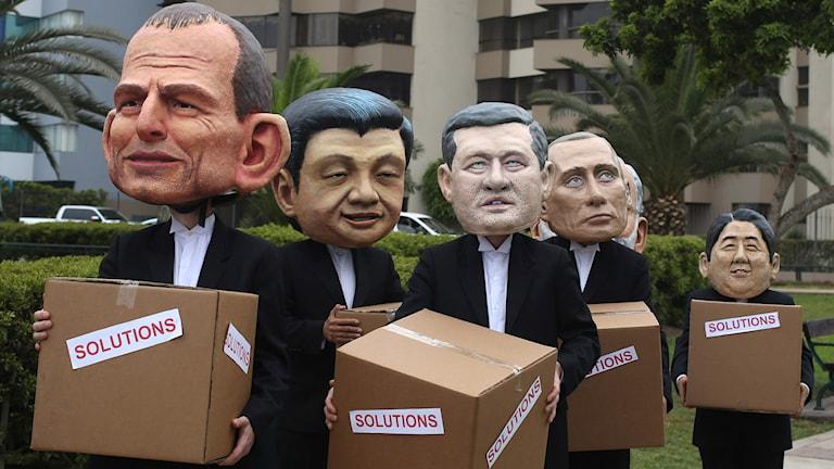 Miljöaktivister protesterar under klimatkonferensen i Lima. Foto: Martin Mejia/AP.