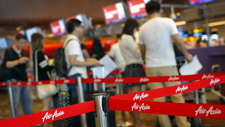 AirAsias check-in desk på Singaporeflygplatsen. Foto: Wong Maye-E/TT