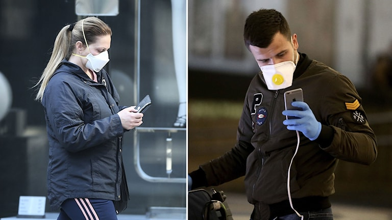 Två personer med skyddsmasker som håller på med sina mobiltelefoner.