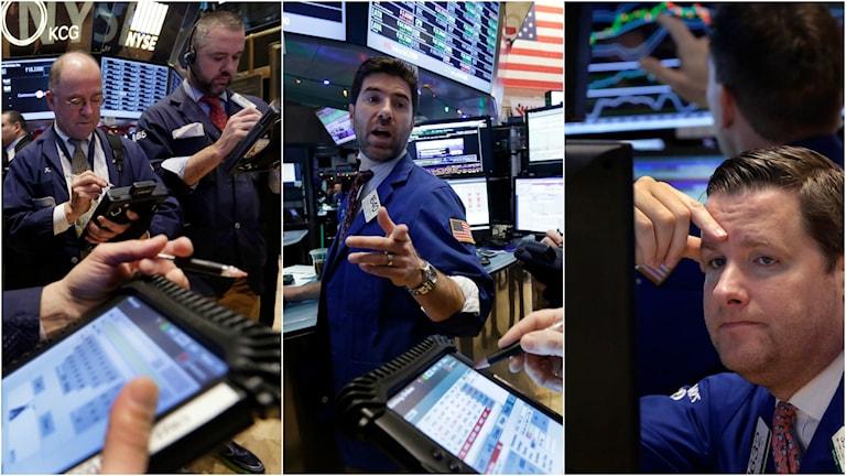 Börshandlare med ipads och aktier i högsta hugg.