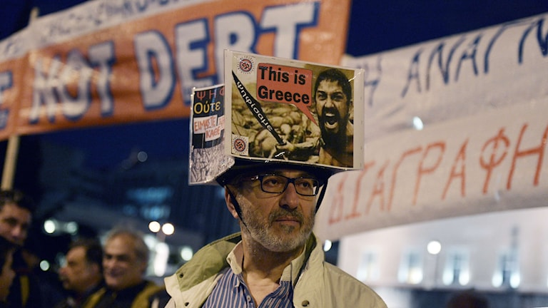 En demonstration till stöd för den grekiska regeringen i Aten. Foto: LOUISA GOULIAMAKI/TT