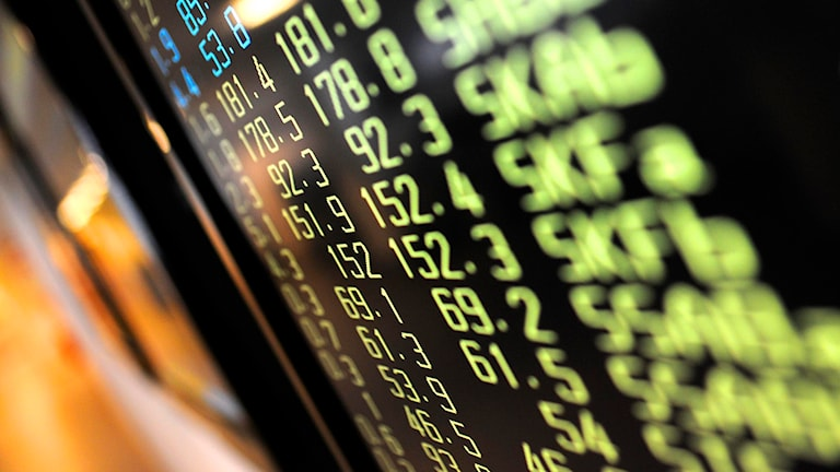 Gula börskurser på text-TV skärmar. Foto: Fredrik Persson/TT.