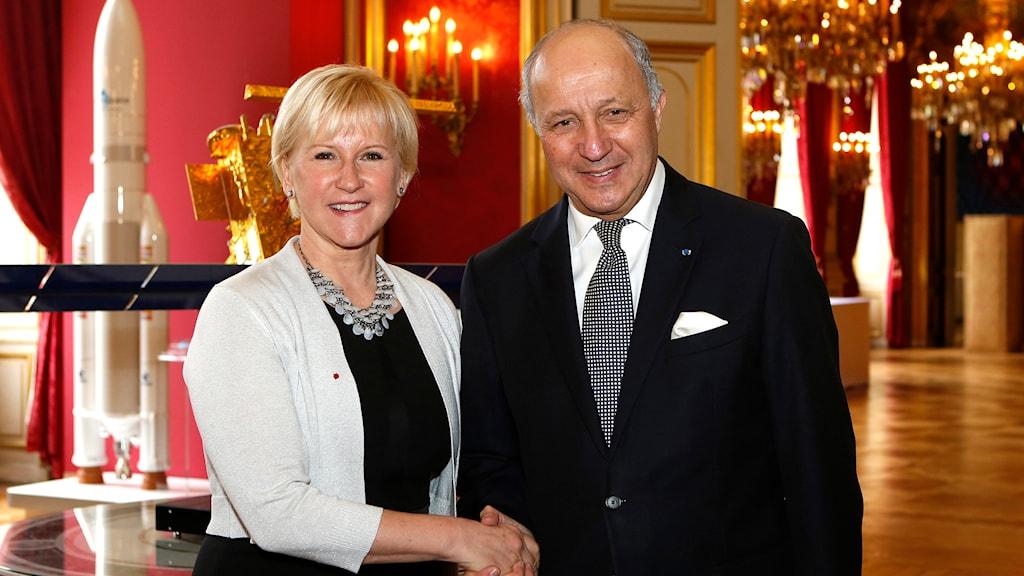 Sveriges utrikesminister Margot Walllström och Frankrikes utrikesminister Laurent Fabius. Foto: Frédéric de La Mure