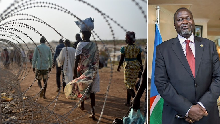 Människor går längs med taggtråd utanför FN-bas i huvudstaden Juba.