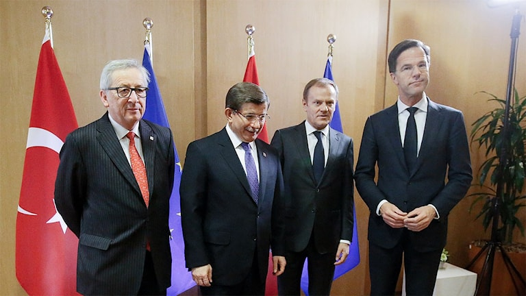 Turkish Prime Minister Ahmet Davutoglu, second left, poses with from left, European Commission President Jean-Claude Juncker, European Council President Donald Tusk and Dutch Prime Minister Mark Rutte