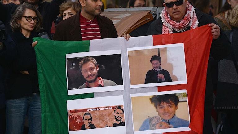 En italiensk flagga med bilder av den mördade studenten Giulio Regeni.