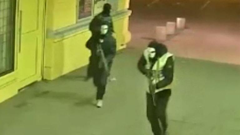 Masked men with guns