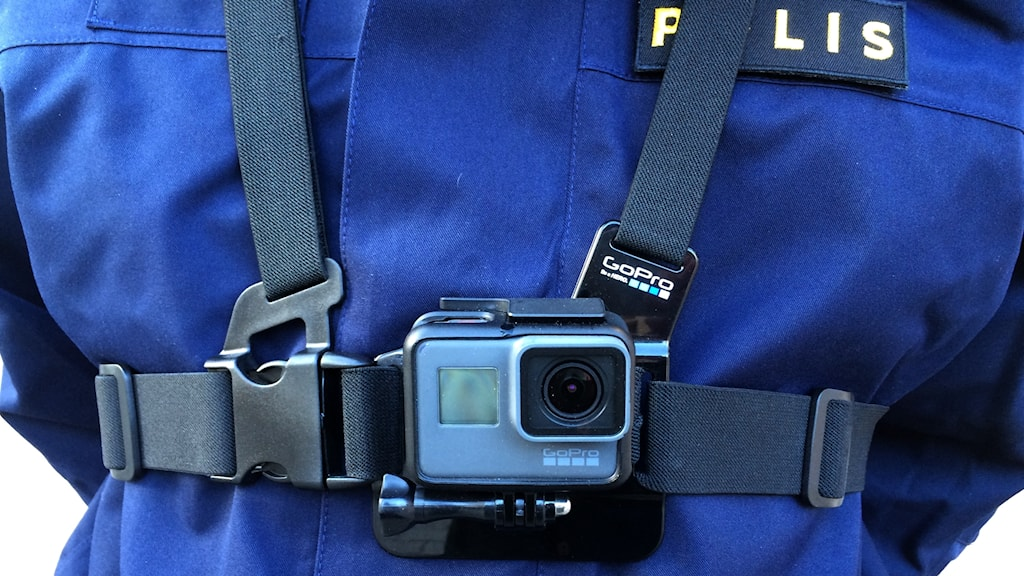 A uniformed police officer with a body camera