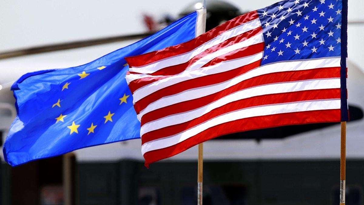 EU:s och USA:s flaggor.