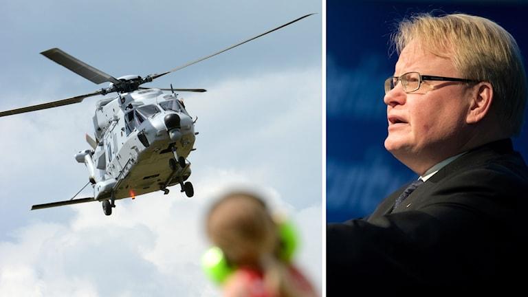 försvarsminister Peter Hultqvist och en helikopter.