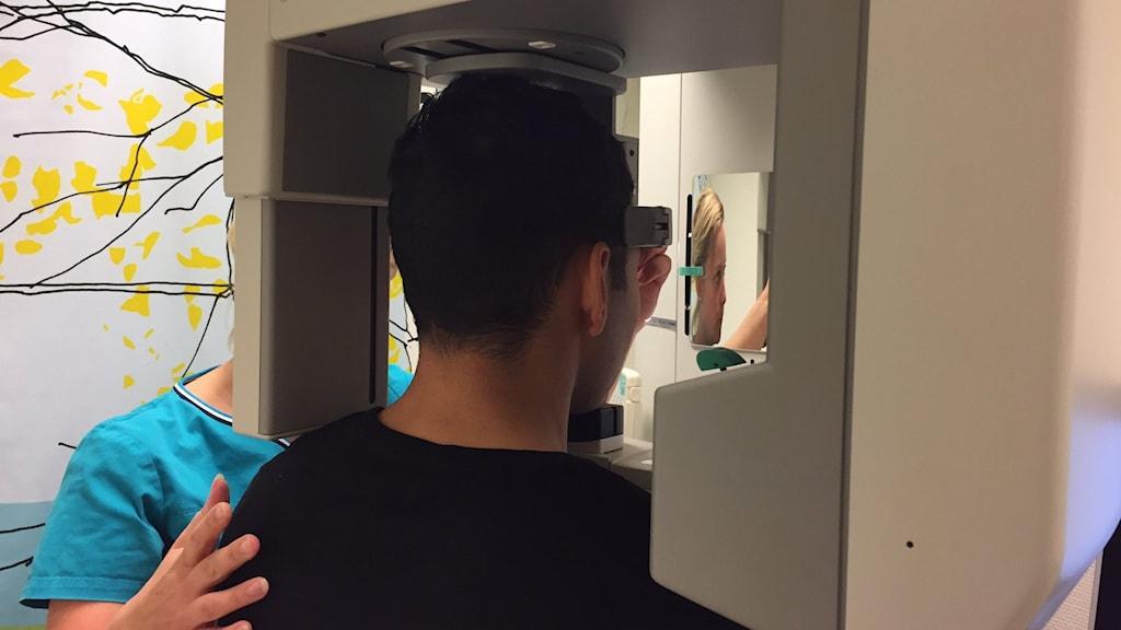 Young man having his teeth x-rayed.