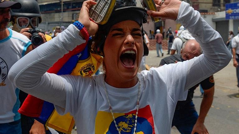 Lilian Tintori, wife of jailed Venezuelan opposition leader Leopoldo Lopez, gestures during a protest against Venezuelan President Nicolas Maduro, in Caracas on April 19, 2017.