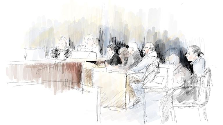 Teckning inifrån rättssalen.