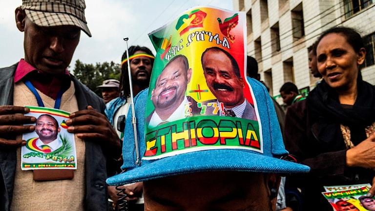 Keps med bilder på Etiopiens premiärminister och Eritreas president.