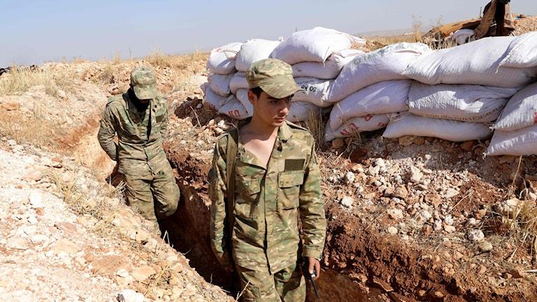 Rebeller vid frontlinjen i Aleppo