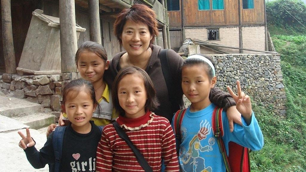 Den kinesiska kvinnorättsadvokaten Guo Jianmei (i mitten).