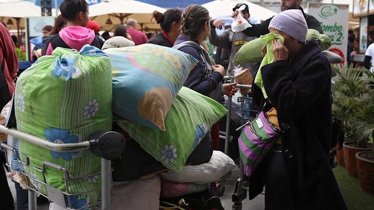 Migranter från Venezuela anländer med buss till Perus huvudstad Lima efter en 20 timmar lång resa.