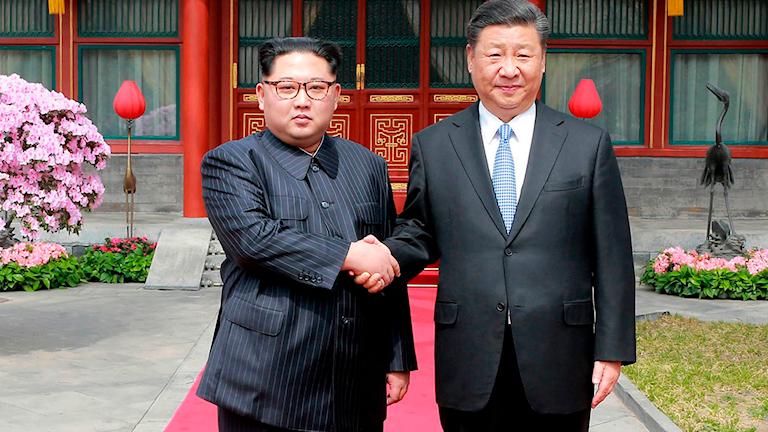 Kim Jong-Un och Xi Jinping när de möttes i Beijing, Kina, i mars 2018.