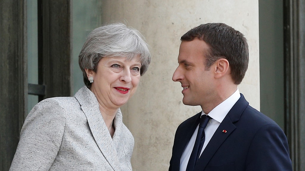 Theresa May och Emmanuel Macron.