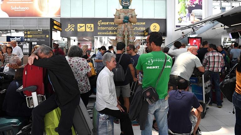 Strandade resenärer vid Suvarnabhumi International Airport in Bangkok. Foto: LILLIAN SUWANRUMPHA/TT.