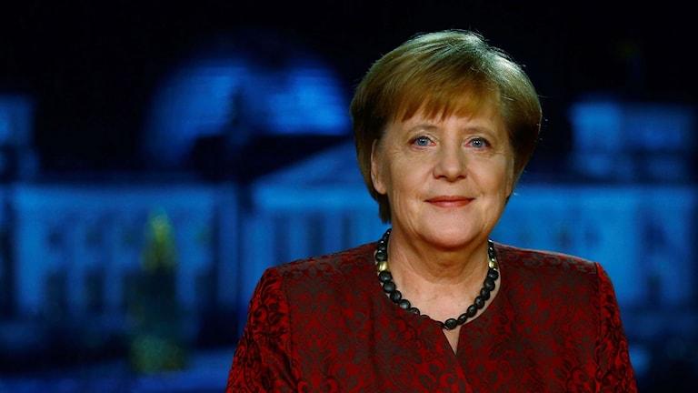 Angela Merkel under sitt tal på nyårsafton.