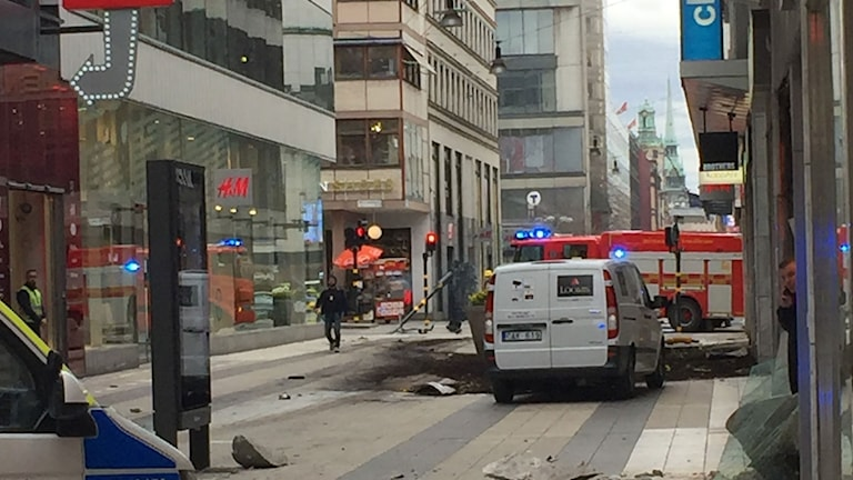 En lastbil har kört in i folkmassorna vid Åhléns i Stockholm.