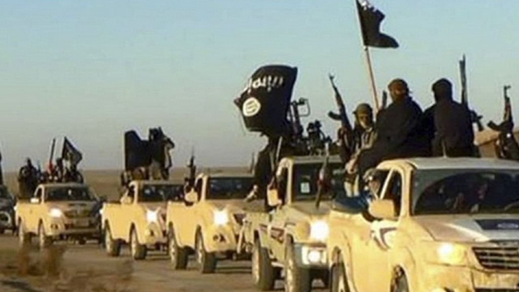 Terrorgruppen IS, beväpnade i sina bilar.