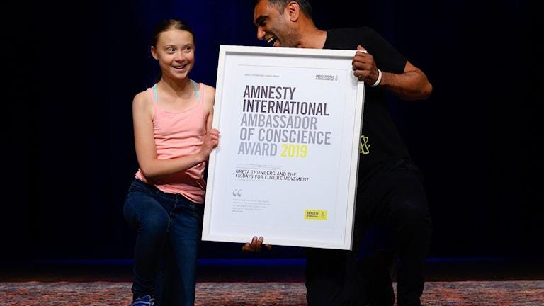 Greta Thunberg med Amnesty Internationals generalsekreterare Kumi Naidoo. Foto: ANDREW CABALLERO-REYNOLDS/TT.