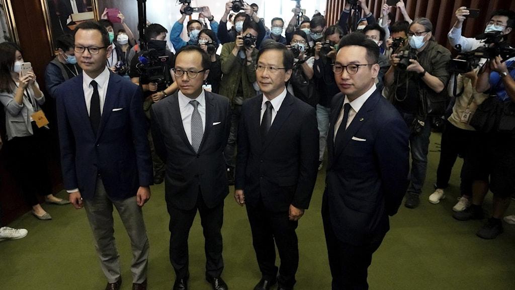 Fyra parlamentsledamöter i Hong Kong.